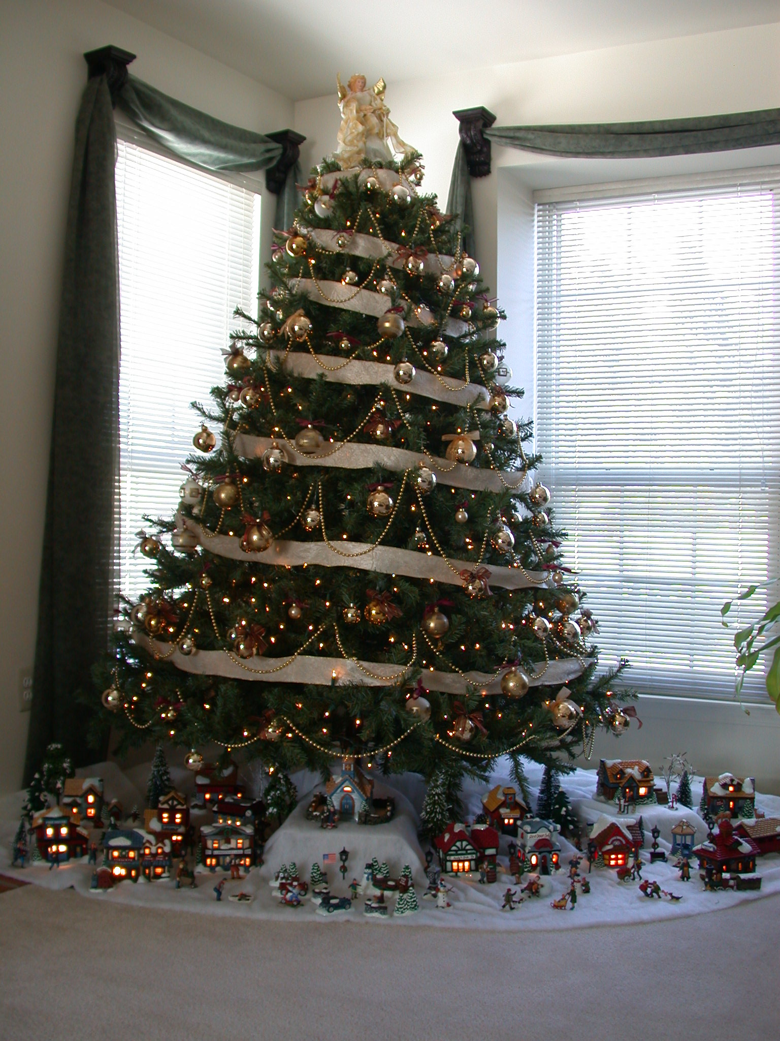 Image Christmas Tree With Village Underneath